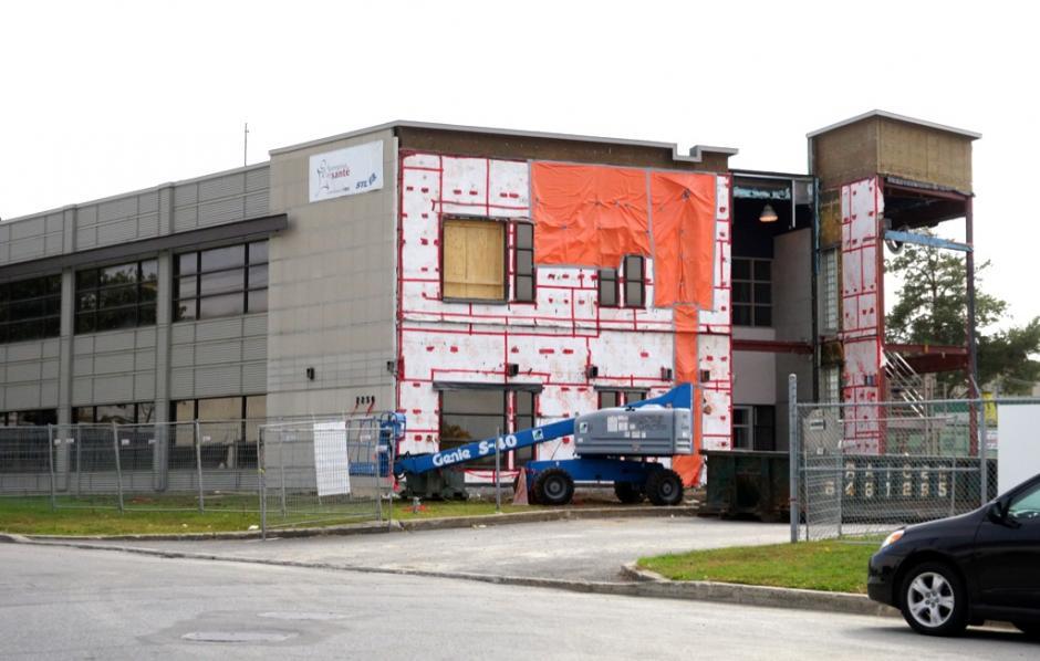 La STL procède à un agrandissement de ses bureaux - Société - Courrier Laval